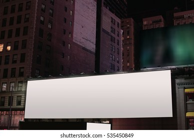 Night City scene with large blank billboard for custom copy space.