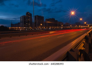 Night city scenery. Slow shutter speed