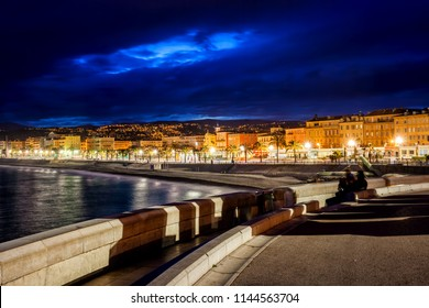 Night city skyline of Nice in France from seaside promenade.