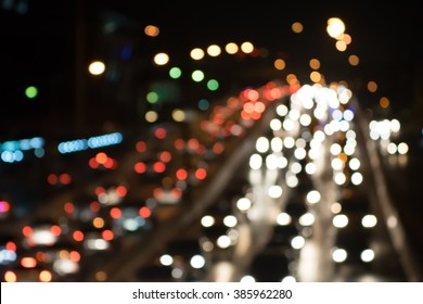Night city street lights background and street lights blur.traffic jam in bangkok