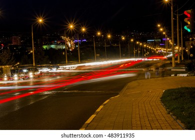 Night city traffic lights all the colors, the movement of cars