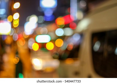 Night city van car and tower street lights bokeh background