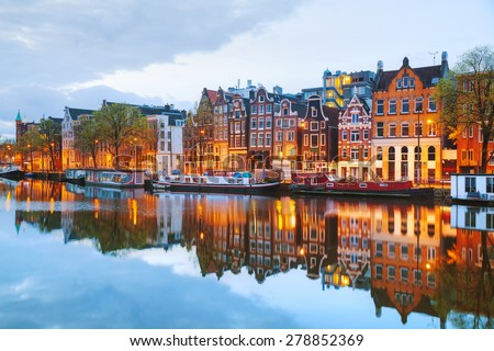 Night city view of Amsterdam, the Netherlands with Amstel river