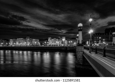 night city view of old town and  kursaal bridge shot from Gros, above urumea river. - Shutterstock ID 1125891581