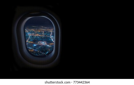 night cityscape from airplane window in the sky with dark place for text, travel and tourism concept