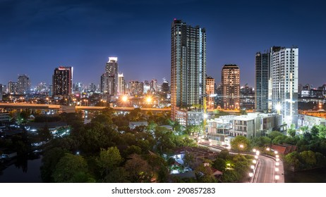 Night Cityscape - Bangkok Skyscrapers and the express road with light trails