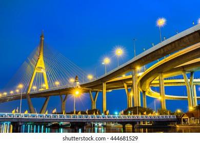 night cityscape at Bhumibol Bridge in Bangkok , Thailand.