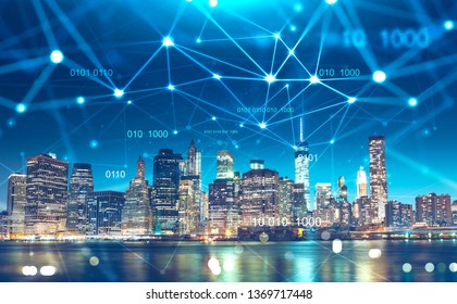 Night cityscape with digital technology interface in the sky. Concept of communication and smart city. Toned image double exposure