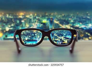 Night cityscape focused in glasses lenses - Shutterstock ID 225924757
