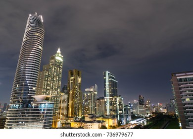 Night cityscape with high tower is office, condominium and hotel in Bangkok city, Thailand