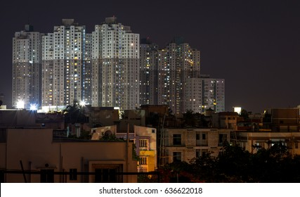 Night cityscape of low and high rise buildings of Kolkata, India.