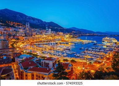 Night cityscape of Monte Carlo by marina, riviera of Monaco
