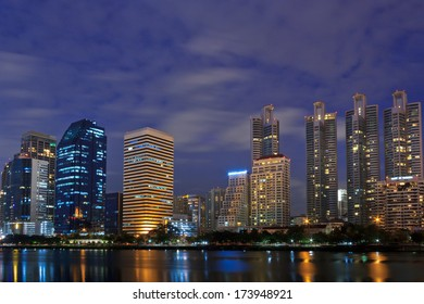 Night cityscape, office buildings and apartments in Thailand . View from public park.