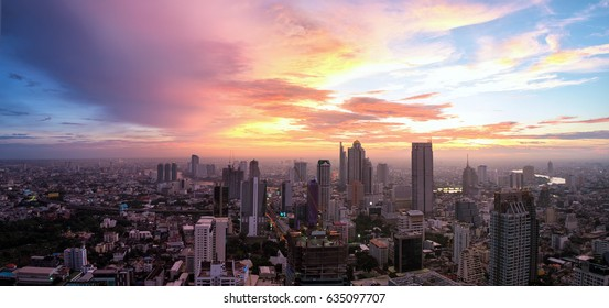 Night cityscape panorama with majestic cloud after sunset in Bangkok, center of economic in Thailand