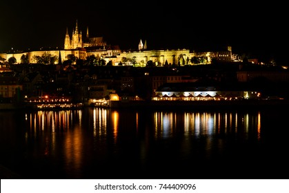 Night cityscape of Prague Old town, St. Vitus Cathedral reflecting in Vltava river