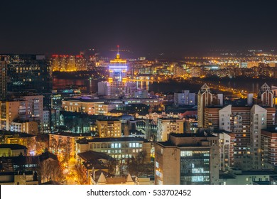Night cityscape from rooftop to Voronezh downtown. Modern houses, trade centers