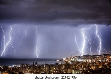 Night cityscape with strong lightning, majestic view on coastal town in dark stormy night, dramatic sky scape with bright zipper