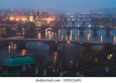 Night cityscape view from Letna Park of Old Town Prague and iconic landmarks like Charles Bridge over the Vltava River in the Czech Republic capital city. - Shutterstock ID 1930121435