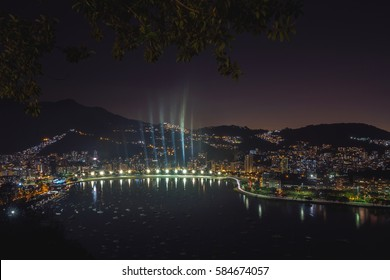 Night cityscape view from the Sugarloaf mountain on the Guanabara bay, Botafogo beach and district, Flamengo district. Rio de Janeiro, Brazil.