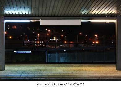 Night closeup of an railway boarding platform in Portugal
