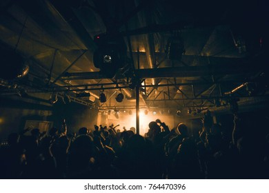 Night club dj party people enjoy of music dancing sound with colorful light, smoke machine, lights show and dance show. Hands up in the earth.