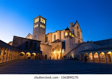 Night is coming on San Francesco d'Assisi Cathedral, a beautiful church in Umbria, Italy. Famous to be the burial site of San Francesco, it's one of the most iconic place for Christian people.