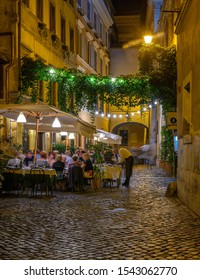 Night cozy old street in Trastevere in Rome, Italy. Trastevere is rione of Rome, on west bank of Tiber in Rome. Architecture and landmark of Rome