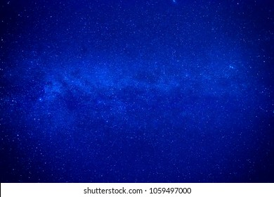 Night dark blue sky with many stars and milky way galaxy