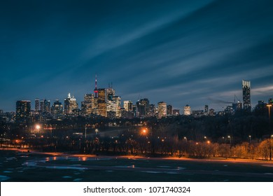 The night downtown Toronto, Ontario Canada city skyline view from Riverdale park. Office buildings, condominiums and apartments all illuminated at night.
