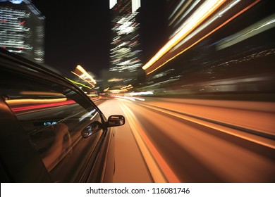 Night drive with car in motion.