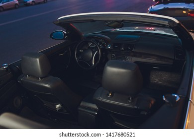 night driving a convertible with the top down.