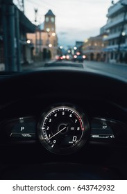 Night driving, view from inside car, city and other cars light is motion blurred