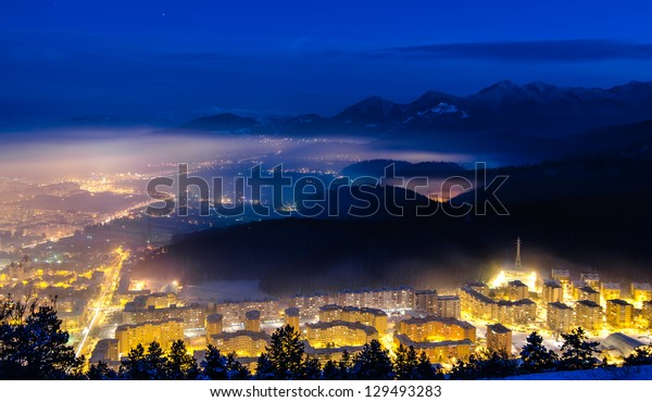 A night exposure over Brasov city with Piatra Mare mountains in the background