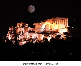 Night extreme zoom shot of iconic Acropolis hill and the Parthenon, Athens historic center, Attica, Greece