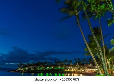 Night Falls On Napili Bay And The Island Of Maui With The Napili Kai Beach Resort Lit Up In The Foreground And Molokai In The Background