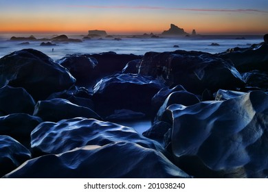 Night falls on tide pools and rocks at Rialto Beach in Olympic National Park, Washington, USA
