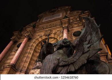 Night Fight. Saint-Michel fountain at Paris, France. Dragon and Archangel Michael at background slaying the devil.