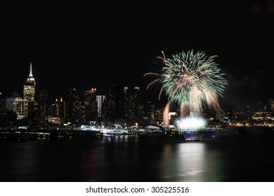 Night fireworks on Hudson River with New York skyline on background
