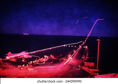 Night flight operations aboard the aircraft carrier USS SARATOGA during Operation Desert Storm of 1991. Feb. 1 1991.
