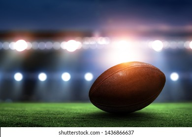 Night football arena in lights with a ball close up