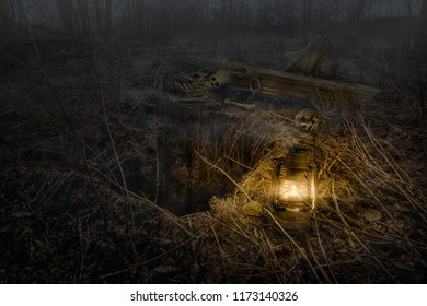 In the night forest in the light of a lamp near the pit found human bones