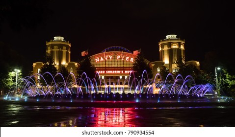 At night Fountain lights  in front of the Navy Pier facade at Chicago, IL, USA on the 4th August, 2017