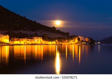 Night full moon panorama of Klek city, tourist resort in Croatia, Europe