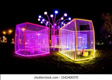 Night garden in al malaz street at Riyadh Season 23 Oct 2019 Saudi arabia - General Authority for Entertainment - Illuminated seats in Illuminated box