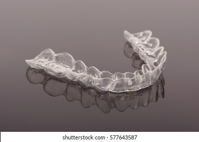 Night guard teeth bruxism protection isolated on the dark background