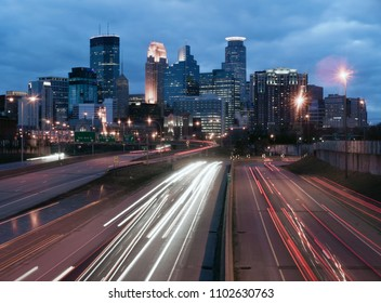 Night has fallen over Minneapolis Minnesota as rush hour traffic still moves on the highways