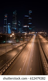 Night highway and Moscow city in the background