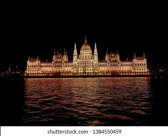 Night Hungarian Parliament in Budapest from the ship, Budapest, Hungary. Cruise on the Danube. Night Budapest. Night building, night lights