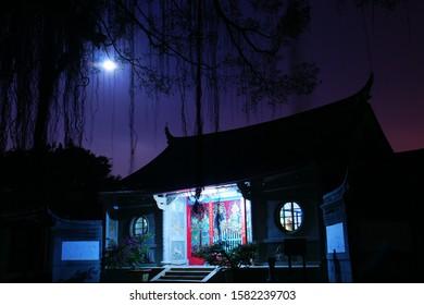 Night illuminated Scenery of Hokkeji Zen Temple, main hall, Stone Buddha and Pagoda & cloudy moonset in Summer solstice.Tainan, Taiwan.