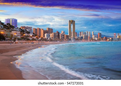 night illumination of Benidorm town with modern housing and coastline